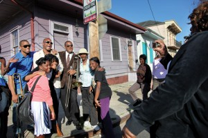 Troy, James and Glen David Andrews pose with their neighbors in Treme. Photo by Elsa Hahne.