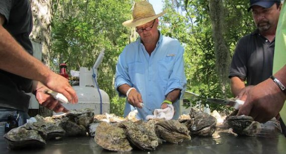 Andrew Zimmern of Bizarre Foods America shucks Louisiana oysters at a backyard crawfish boil in Bayou Pigeon. Photo courtesy of the Travel Channel.
