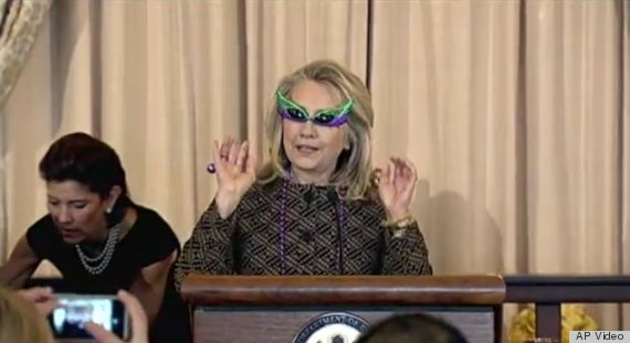 Hillary Clinton Wearing Mardi Gras Beads and Purple Sunglasses