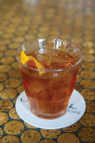Rocking Chair 1 1/2 ounce Booker's bourbon 1 1/2 ounce Disaronno liqueur 2–3 dashes Angostura bitters Orange peel Pour bourbon, liqueur and bitters over ice. Stir. Serve with a nice, fresh sliver of orange peel. Photo by Elsa Hahne.