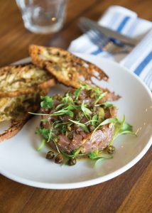 Tuna tartare with Castelvetrano olives, fried capers, pine nuts and za'atar crostini. Photo by Elsa Hahne.