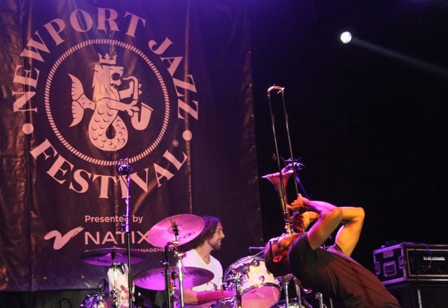 Trombone Shorty and his band, Orleans Avenue, put on a high-energy 90--minute show at Newport Casino, the Newport Jazz Festival's original home.