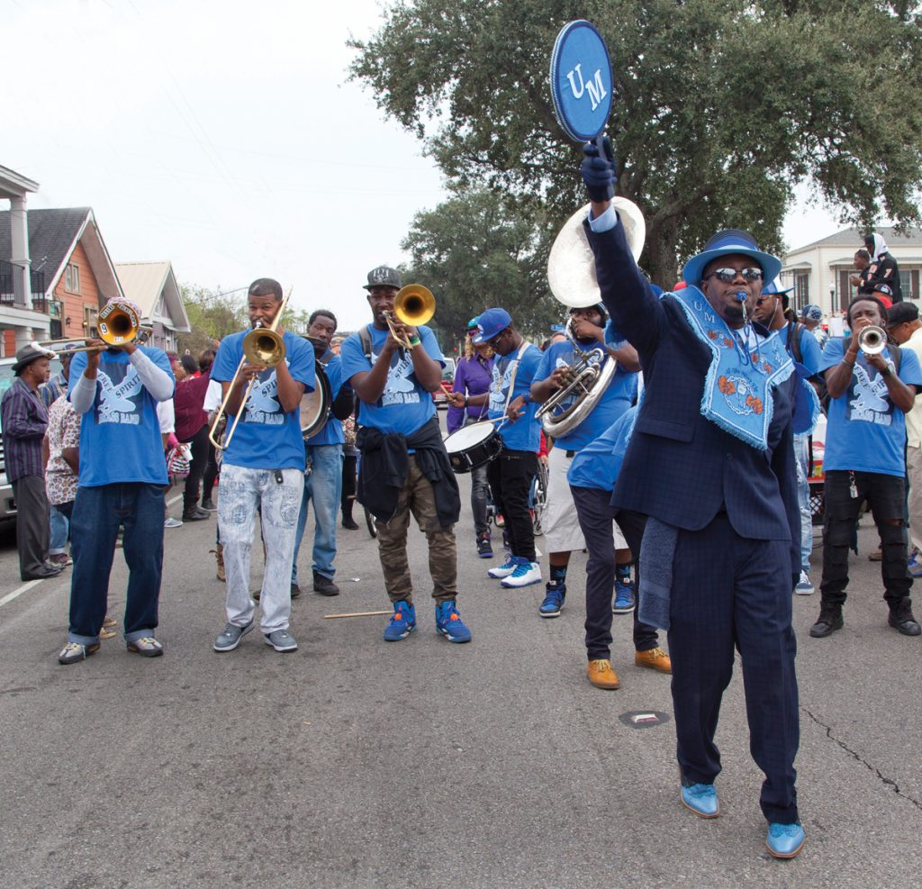 The Free Spirit Brass Band parades with Unbreakable Men. Photo by Judy Cooper.