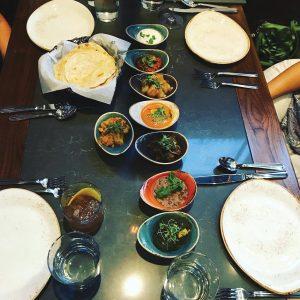 Roti sathi (bread companions): raita, tomato mirchi masala, jeera aloo, daily daal, eggplant Hyderabad, royal paneer, saag. Photo by Elsa Hahne. paneer and gobi