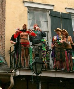 (Obviously) tourists on a Bourbon Street balcony. Photo: Brian Lin