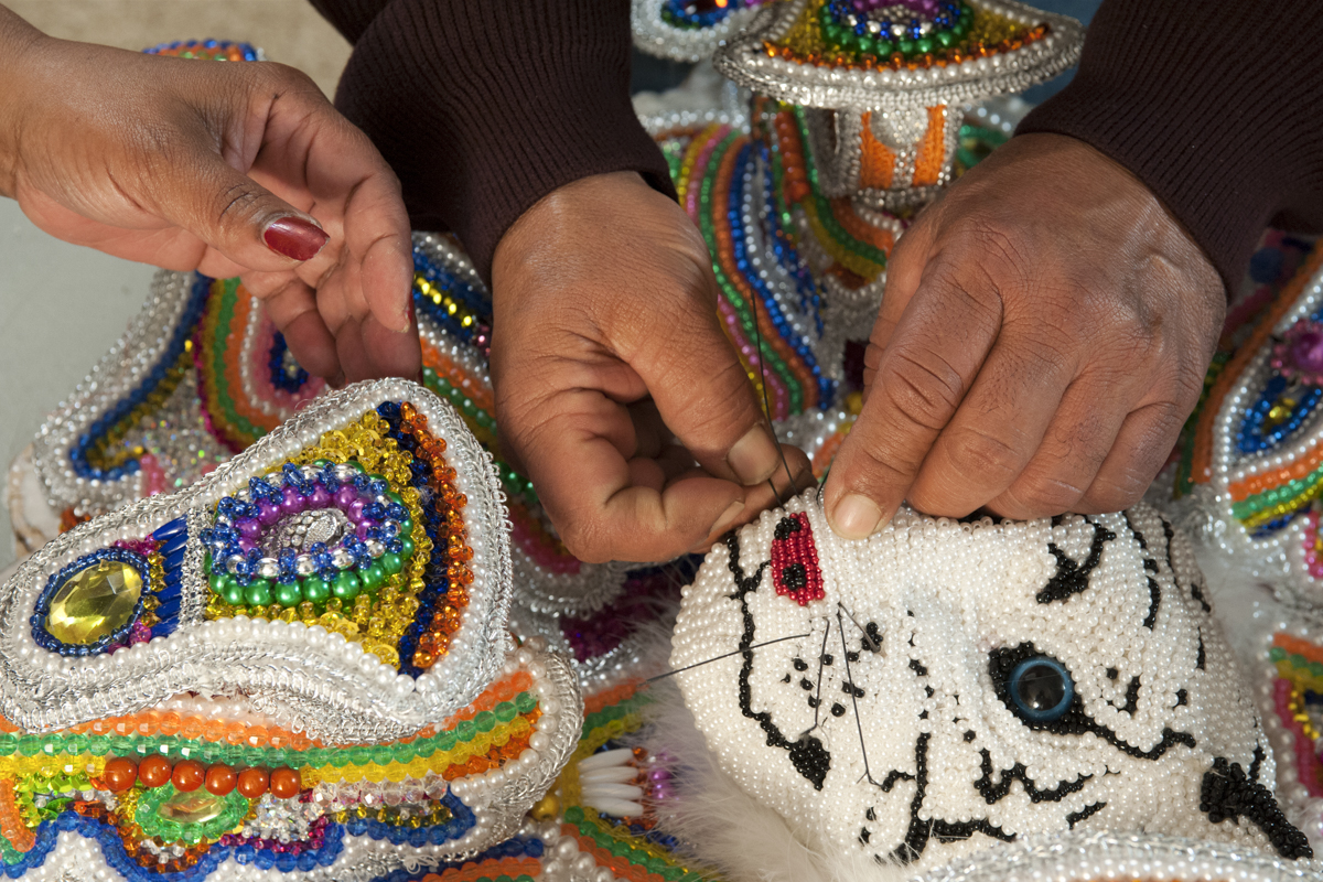 Big Chief Pie and Big Queen Denice work on the Chief's suit on December 7, 2014.