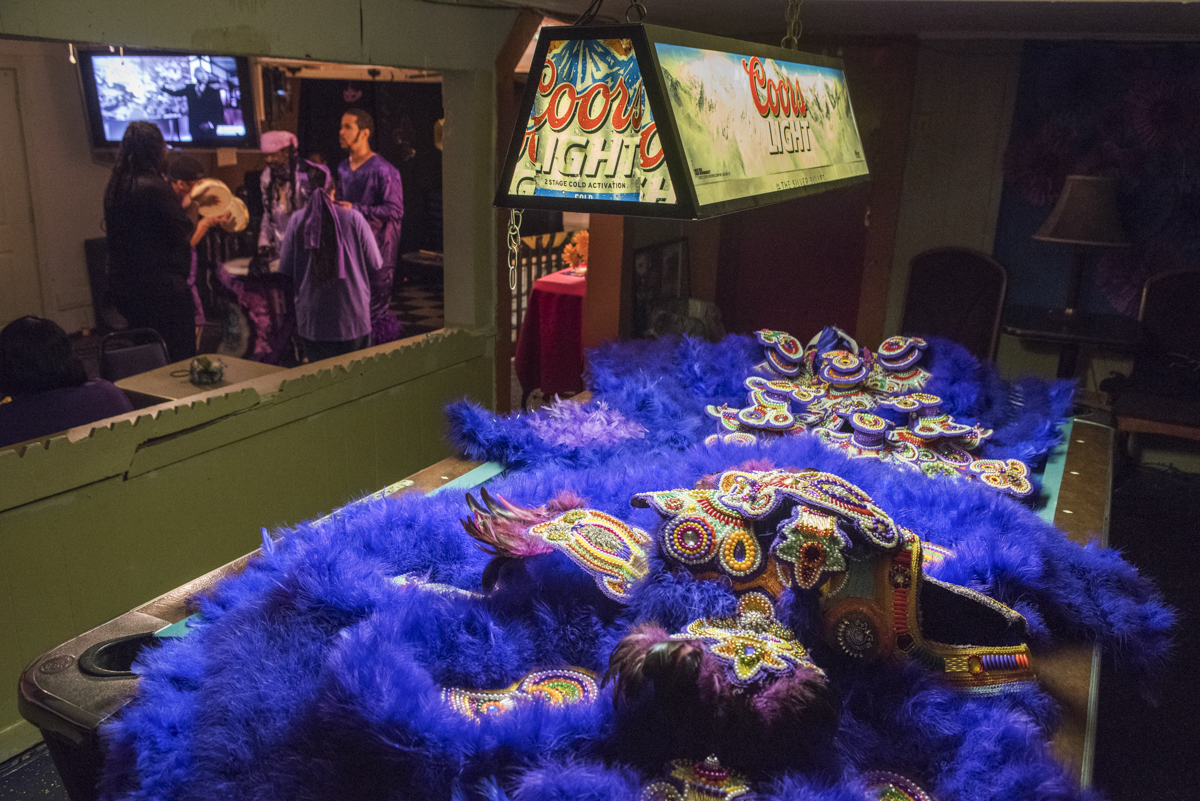 Big Chief Pie's suit laid across the pool table at the First and Last Stop as the tribe closes St. Joseph's with a few traditional Indian songs.