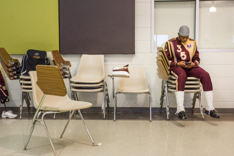 McDonogh 35 Senior High School Marching Band member Claudell Mcdonald waits in the band room before the Mystic Krewe of Femme Fatale parade on February 24, 2019.