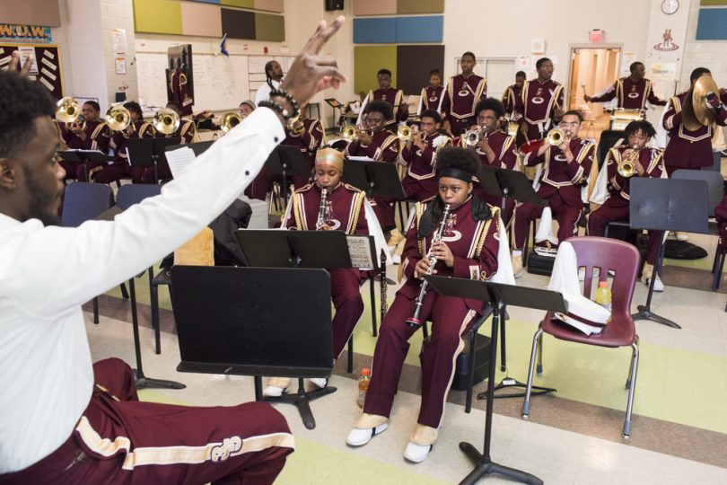 McDonogh 35 Senior High School Marching Band Assistant Director Damien Carter warms up the band before they parade in Mystic Krewe of Femme Fatale on February 24, 2019.