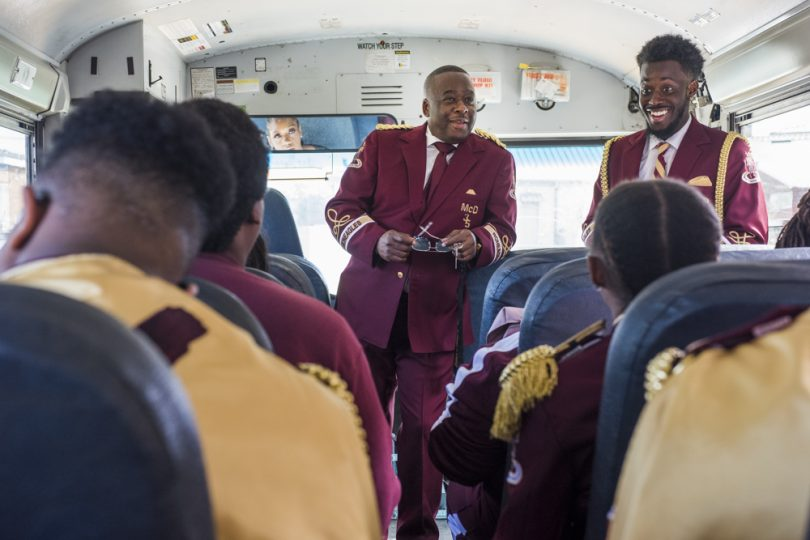 McDonogh 35 Senior High School Marching Band Director Lawrence Rawlins and Assistant Director Damien Carter talk to the band before leaving for the Mystic Krewe of Femme Fatale parade on February 24, 2019.