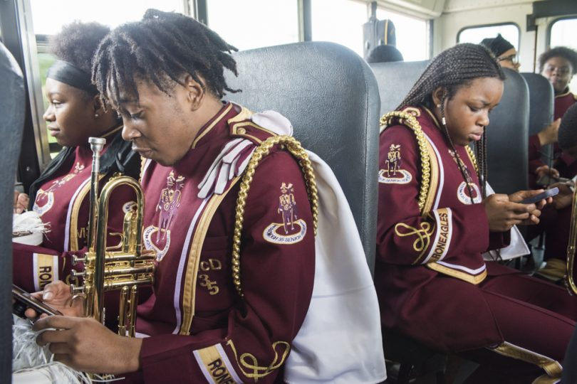 McDonogh 35 Senior High School Marching Band Lyric Andrews, Marvin Wroten Jr., and Kendra Boseman ride the bus to the start of Mystic Krewe of Femme Fatale parade on February 24, 2019.