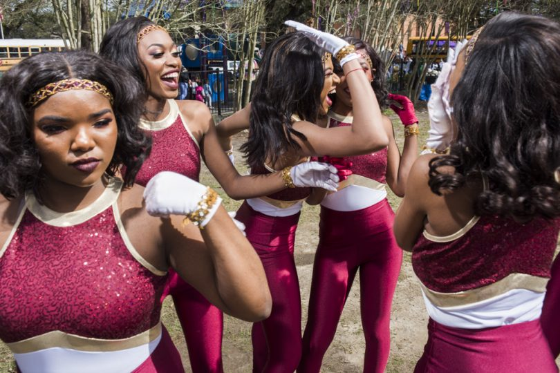 McDonogh 35 Senior High School Marching Band Eaglettes team members Kendra Norris, Nyja White and Brylyia Baptis joke around before they parade in Mystic Krewe of Femme Fatale on February 24, 2019.