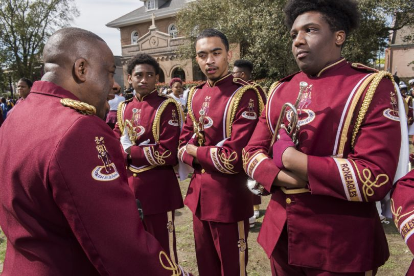 McDonogh 35 Senior High School Marching Band Director Lawrence Rawlins talks with the trumpet section before they parade with Mystic Krewe of Femme Fatale on February 24, 2019.