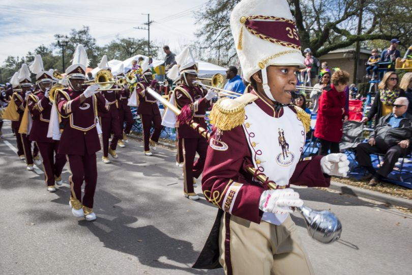 McDonogh 35 Senior High School Marching Band Drum Major Jaelyn Hill leads the band along Napolepon Ave for the Mystic Krewe of Femme Fatale parade on February 24, 2019.
