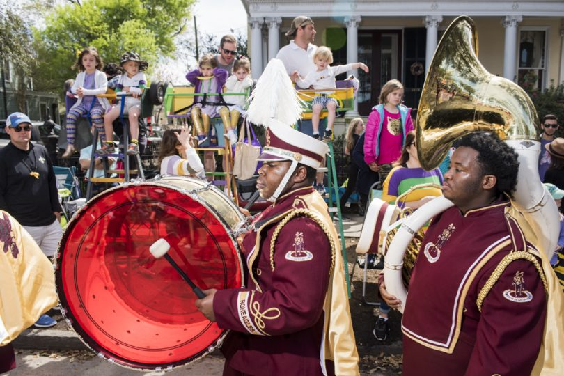 McDonogh 35 Senior High School Marching Band member George Jackson and Christopher Perkins march in the Mystic Krewe of Femme Fatale parade on February 24, 2019.