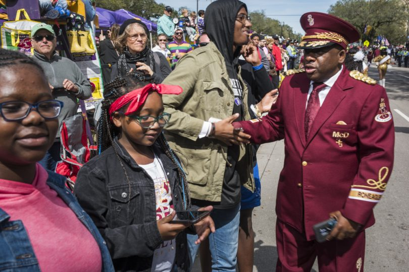 McDonogh 35 Senior High School Marching Band director Lawrence Rawlins greets friends and family along the parade route during the Mystic Krewe of Femme Fatale on February 24, 2019.