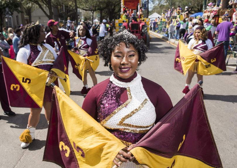 Double Trouble Flag Team member Shynyra Waterhouse marches down St. Charles for McDonogh 35 Senior High School Marching Band during the Mystic Krewe of Femme Fatale parade on February 24, 2019.