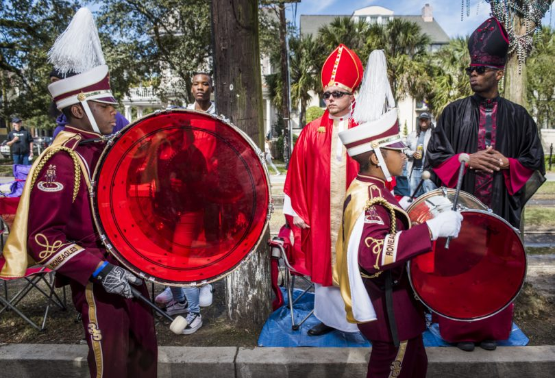 McDonogh 35 Senior High School Marching Band drumers Joseph Parker and Shyra Waterhouse march down St. Charles during the Mystic Krewe of Femme Fatale parade on February 24, 2019.