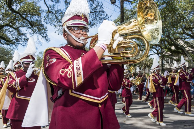 McDonogh 35 Senior High School Marching Band member Theron Sanchez plays along St. Charles Ave. for the Mystic Krewe of Femme Fatale parade on February 24, 2019.