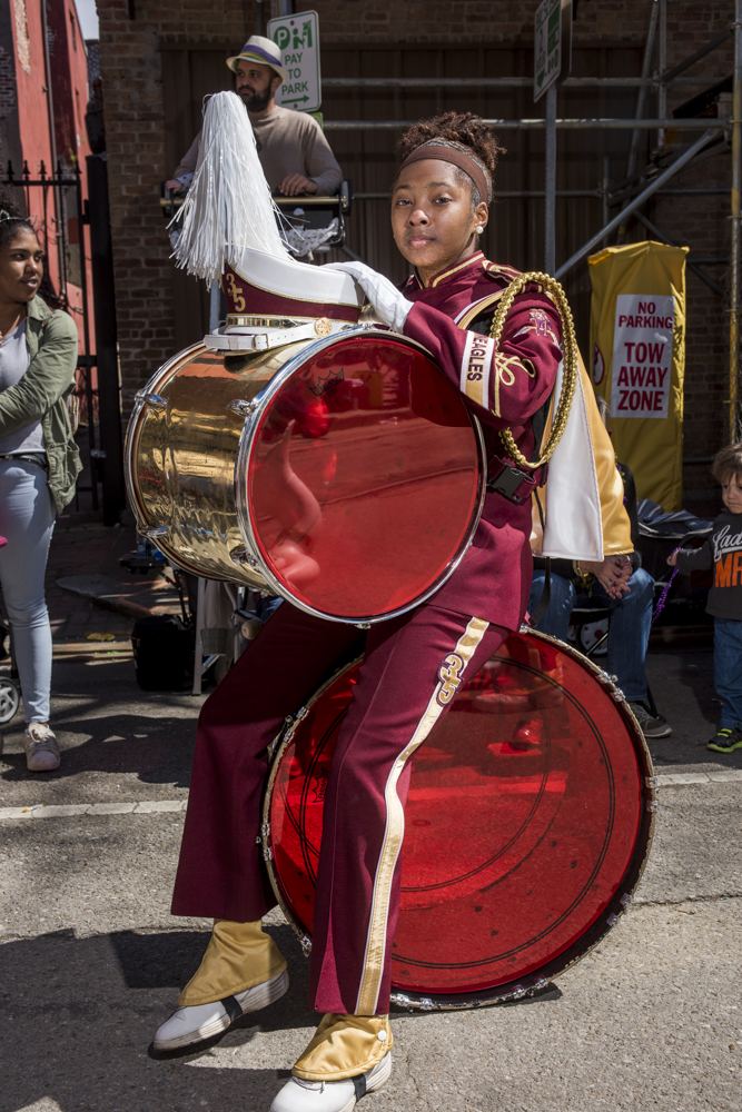 McDonogh 35 Senior High School Marching Band member Shyra Waterhouse sits down during a rare break during the Mystic Krewe of Femme Fatale parade on February 24, 2019.