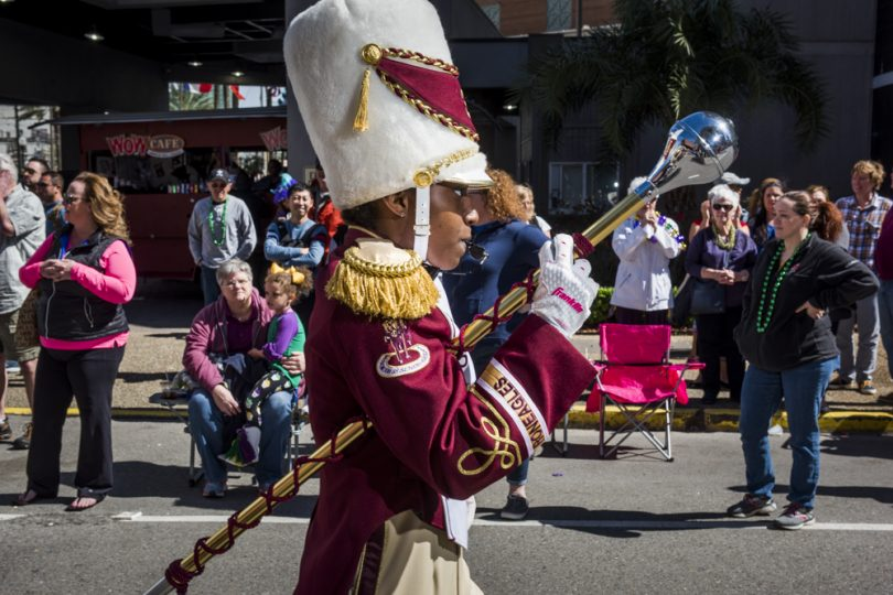 McDonogh 35 Senior High School Marching Band Drum Major Jaelyn Hill leads the band through the CBD during the Mystic Krewe of Femme Fatale parade on February 24, 2019.
