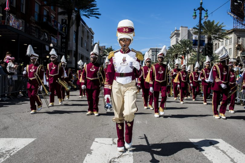Band Drum Major Jaelyn Hill leads the McDonogh 35 Senior High School Marching down Canal Street in the final stretch of the Mystic Krewe of Femme Fatale parade on February 24, 2019.